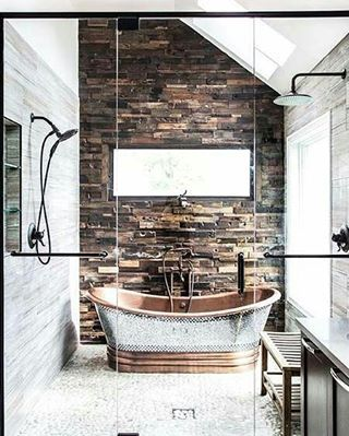 Industrial- copper and metal with very large light fixtures and brick wall.