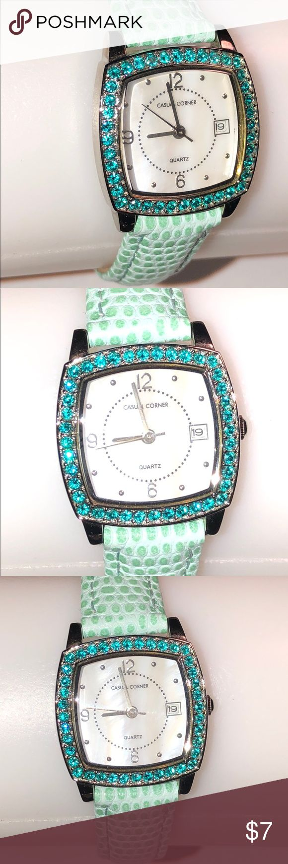Gorgeous Casual Corner Ladies Aqua Quartz Watch This is a super cute aqua watch by Casual Corner. It has a genuine leather, aqua band with a tang buckle closure. It has a square case lined with simulated gemstones. It is a previously used item with some minor use wear, as shown in the pics. The battery is brand new & the watch works great. Casual Corner Accessories Watches