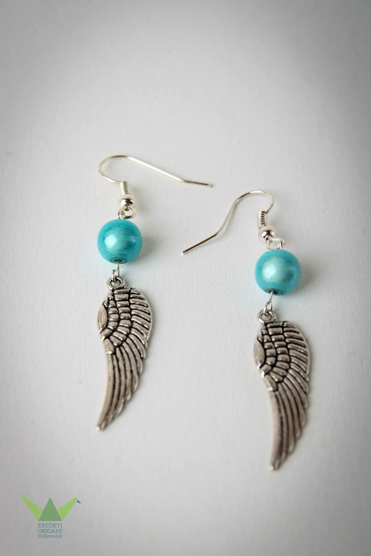 silver angel wing with blue pearl