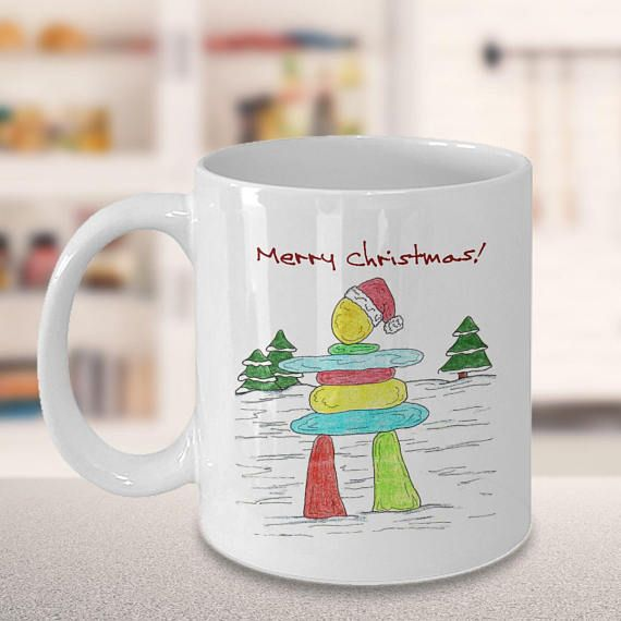 Beautiful colorful original Christmas artwork design - Native American Inukshuk, which is a sculpture of rock and stones in the form of a human figure traditionally used by the Inuit people as a landmark or commemorative sign, on a coffee tea or hot chocolate mug. Original art