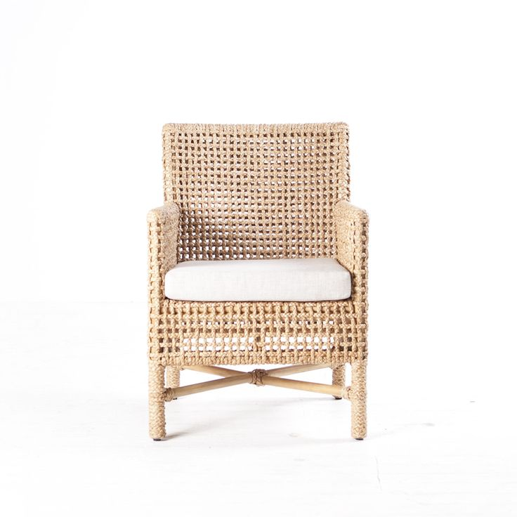 The Banaue Chair is a woven rattan dining chair or occasional chair that sits as well in a lounge room as it does around a dining table. The seat cushion can be customised and upholstered in any one of our fabrics to suit each individual space.