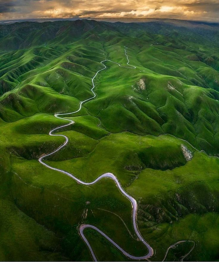 Road along green mountain