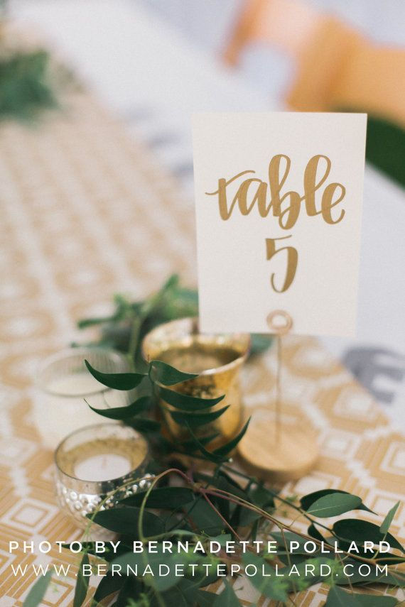 gold calligraphy wedding table numbers handwriting