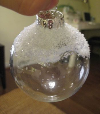 Did it snow on my ornament? Just craft glue and glitter on a cheap clear ball!