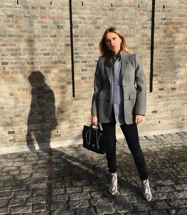 """I luckily still fit many of my oversize blazers, which I almost wear daily for work at the office or when having meetings. I recommend wearing them with either a vintage band T-shirt or an oversize shirt (maybe your boyfriend's?) preferably with vertical stripes—it creates a slimming effect. A pair of """"preggo jeans"""" and boots with a small heel will finish the look. Blazer from Balenciaga, shirt from Balenciaga, jeans from Mango, boots from Vetements."""