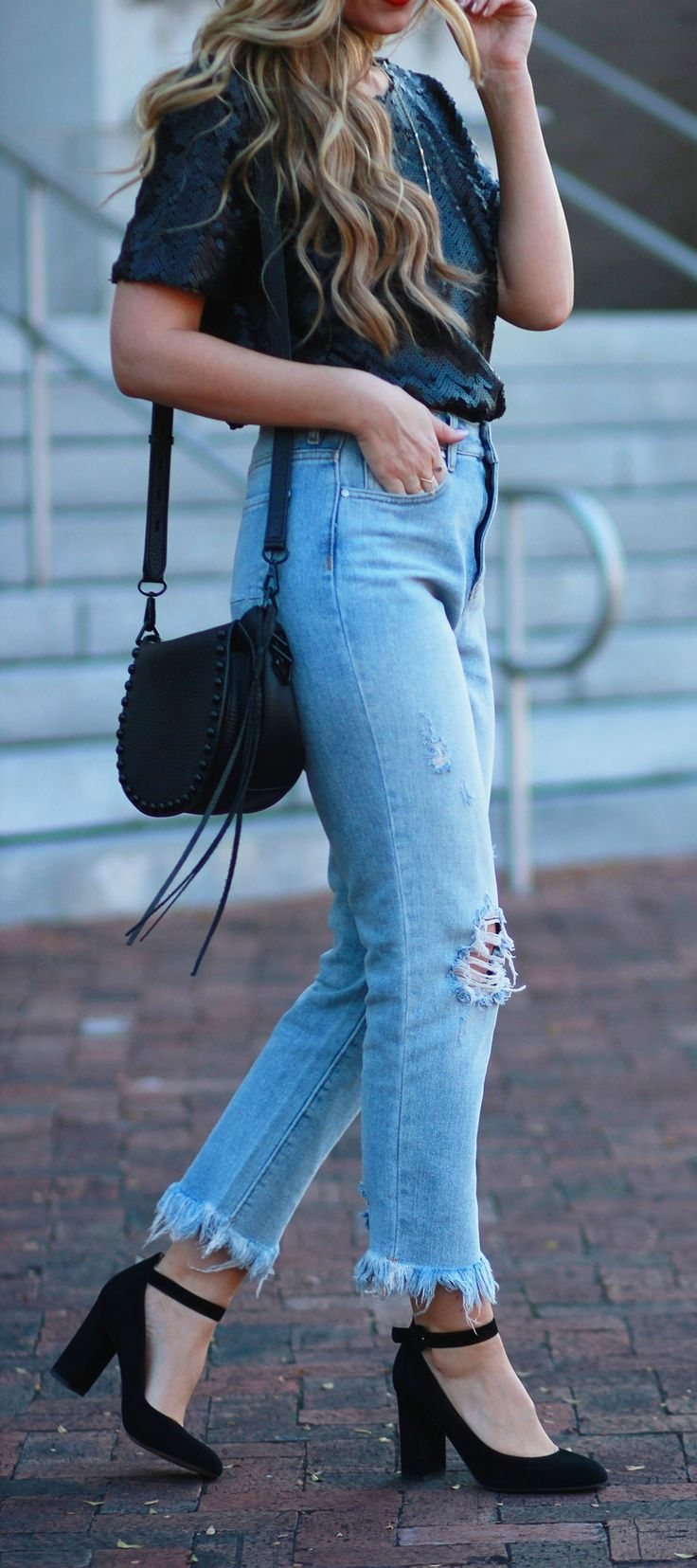 Casual holiday and New Years Eve outfit styled with back sequin top, frayed cropped jeans, suede mary jane heels and red lipstick