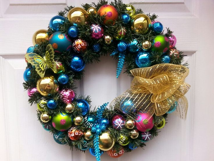 This is a colorful and fun wreath. Many of the balls have Happy Holidays written on them. Came out so pretty.