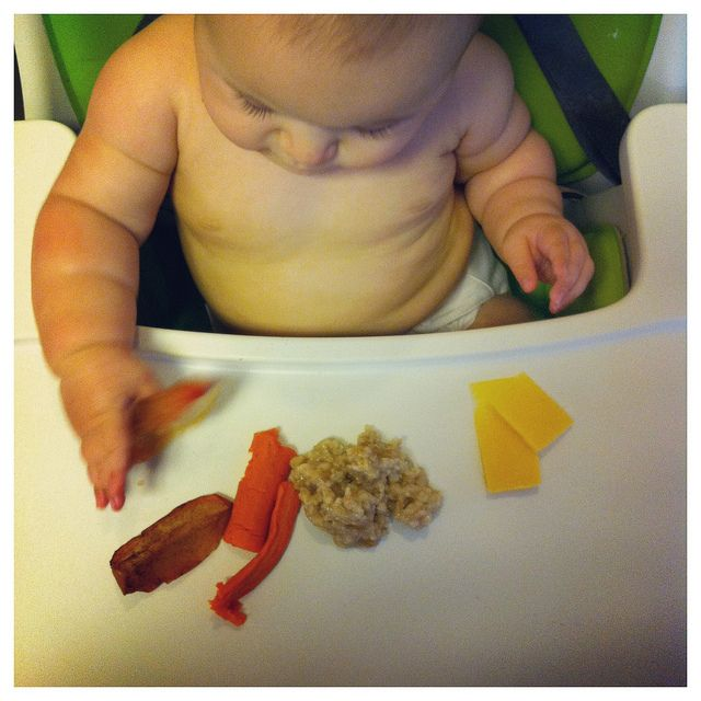 Baby Led Weaning - can not recommend this enough! We could not get Han to take solids until we read this book and once starting it she fed herself from day one (except for yogurt and runny things)! It's great!
