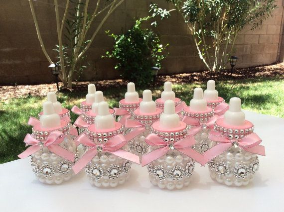 Baby bottles are 3.5 decorated with your baby shower theme. Does not include candies. They are made of bards plastic, you can open them and