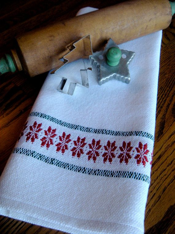 Handwoven Christmas hand towel designed with a lively border of red Nordic stars in 100 percent cotlin. A traditional Swedish weaving pattern