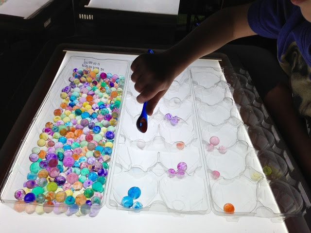 scooping and sorting water beads