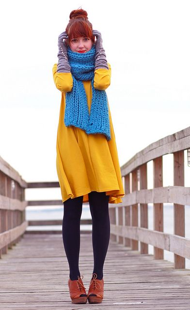 digging a chick who can pull off a yellow dress, red hair and blue knit.  rock the primary colours