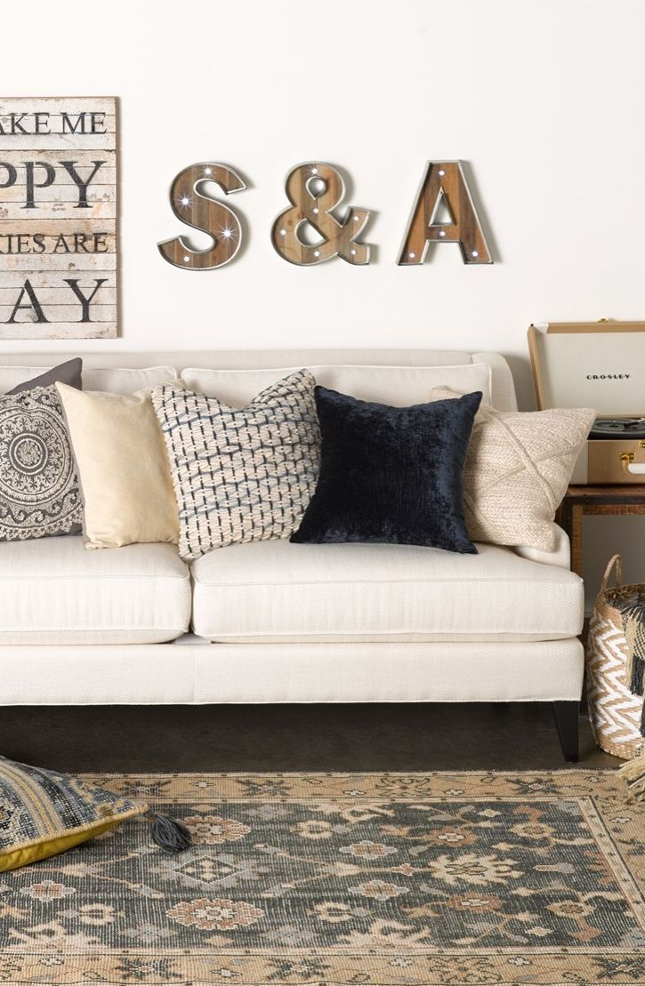 Adding a sweet, personal touch to the living room with these fun illuminating marquee letter signs.