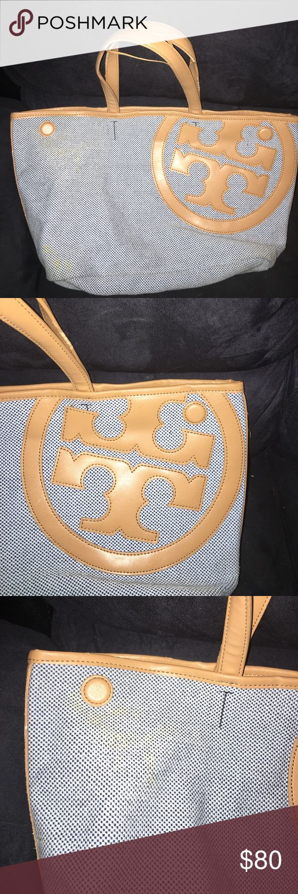 Tory Burch Small Tote In good condition. There is a small stain on the front that is so slight I couldn't get a good picture of it. A little Dawn, vinegar and a toothbrush should take care of it. The handles are stripping. Clean inside. Straps long enough for shoulder or carry as a tote the straps are a light tan color while the bag is a tweed in blue and white. Beautiful just too small for me. Tory Burch Bags Totes