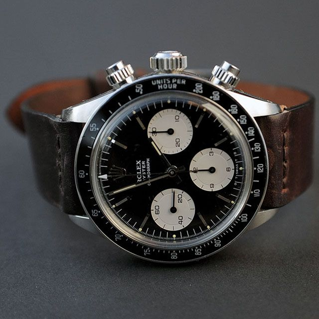 I am really liking a classic Rolex with a non-metal strap, it tones it down really nice!  Rolex Daytona Chronograph