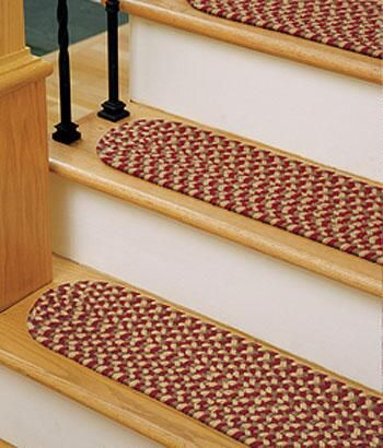 Traditional style meets modern practicality. This colorful and durable stair tread matches perfectly with our Rain-or-Shine braided rug and chair pads. Choose Black, Blue, Burgundy, Camel Multi, Navy Multi, Red, Red & Black Multi, Red & Gold combo, Sage or Spruce Green. (Country Curtains Rain-or Shine Braided Stair Tread)