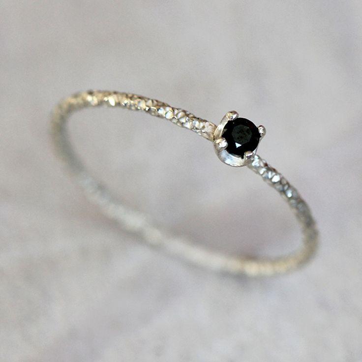 Black diamond solitaire ring