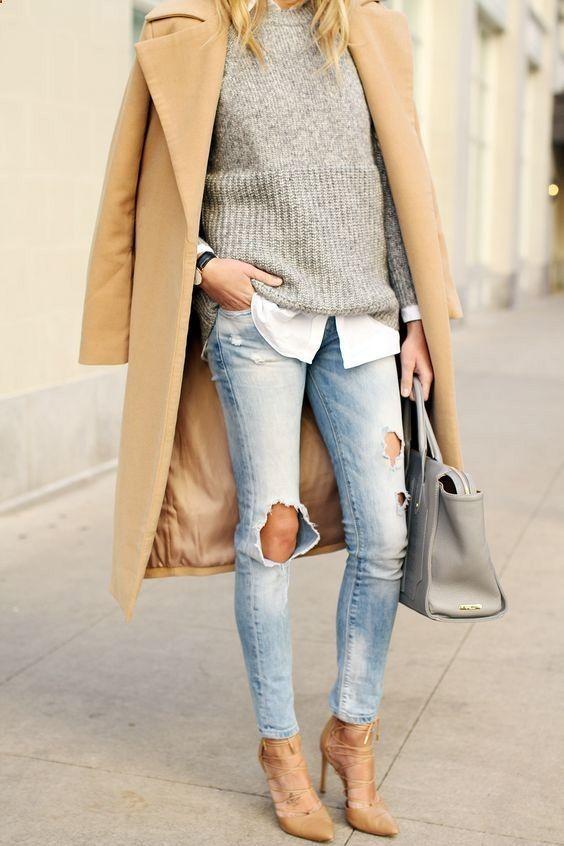 camel coat / grey sweater / white shirt / ripped denim blue jeans / grey handbag /camel heels