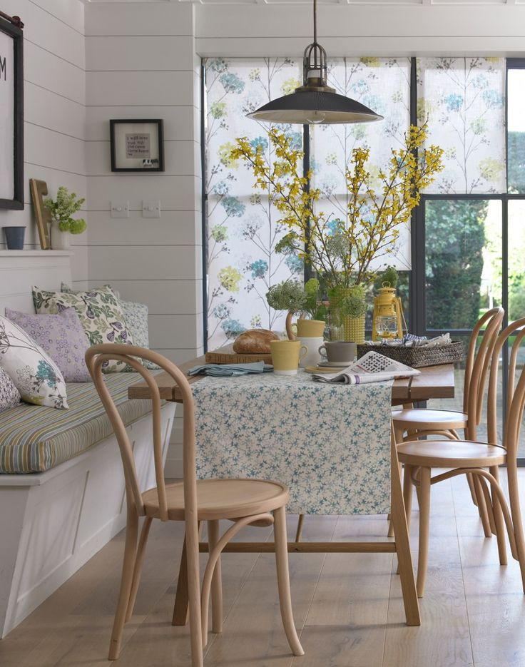 bright accessories really lift this all white dining room country