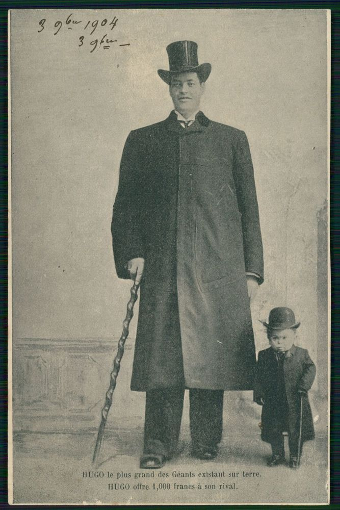 Circus freak Giant Tall man HUGO and Midget original old 1910s postcard