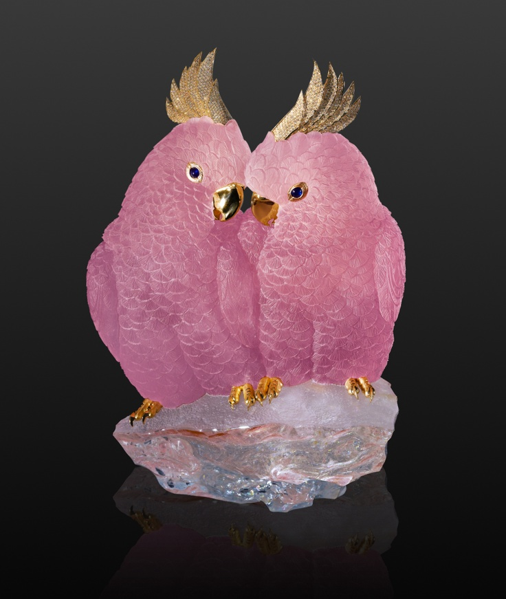 """THE LOVE OF THE COCKATOO    ...is a jewel.  The partnership between wild parrots endures a lifetime: indivisible. Symbolising the lifelong pairing, the lovebirds are hand-cut from a single morganite crystal, which includes a dramatic natural colour line marking their perch.    """"cockatoo pair"""", Brazilian morganite with sapphire eyes, brilliant-cut diamonds, 18 ct yellow gold  h 8.7 in"""