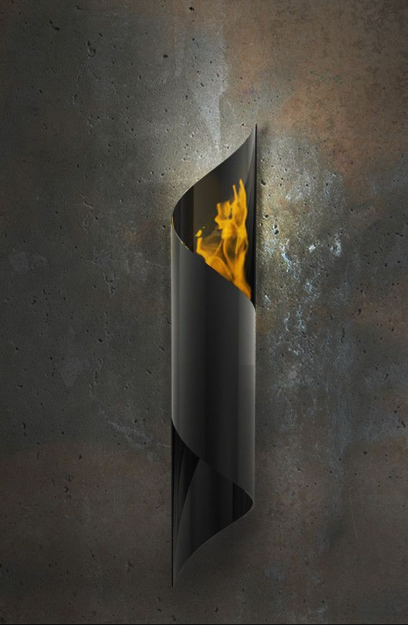 Nuvo (Gunmetal Grey) Wall-Mounted Fireburner is a single swirling piece of solid steel #ecofriendly #bioethanol #fireplace #wallmounted  http://www.firenflame.com/