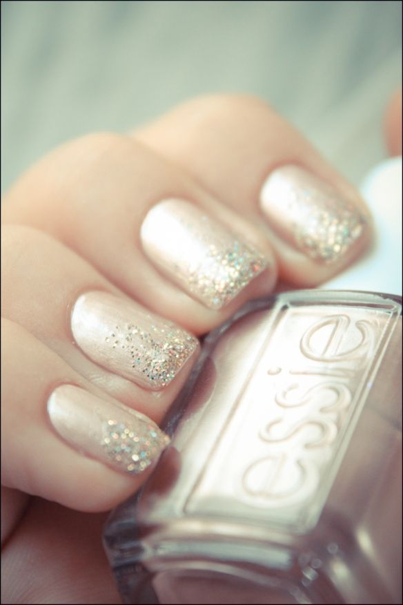 Glitter ombre gradient glitter manicure over pale pink nail polish