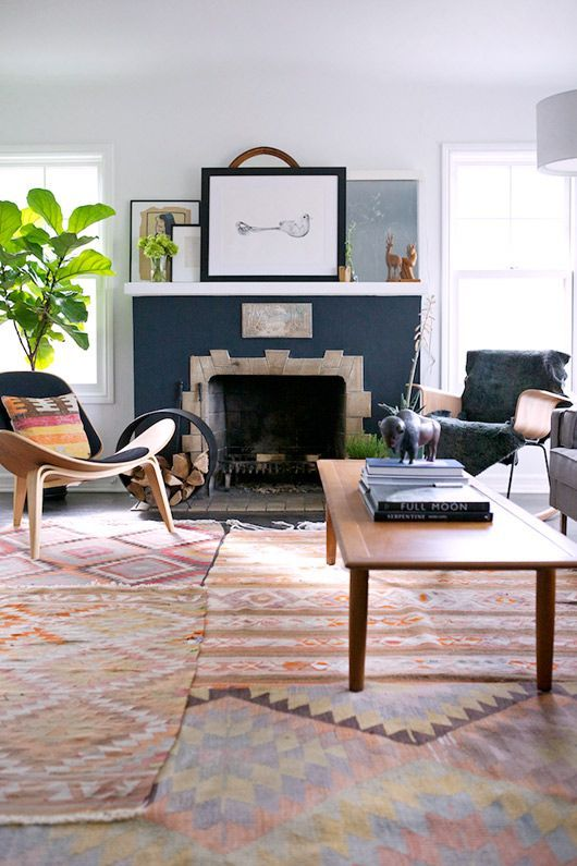 So Many Things That Work In This Living Room The Overlapping Rugs Teal Color Around Stone Of Fireplace Big Leafed Plant From THE STYLE