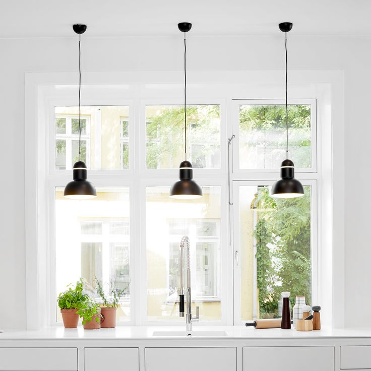 Boform Hellerup, Showroom. Jet Black Anglepoise® Type 75™ Maxi Pendants and a Type 75™ Wall Light