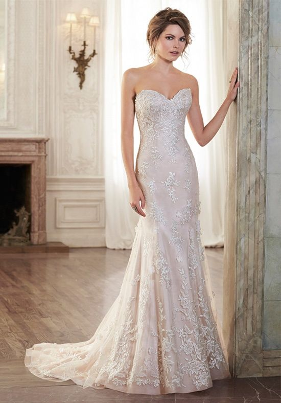 Spectacular Maggie Sottero Holly Timeless romance is found in this slim A line wedding dress featuring a delicate sweetheart neckline and lace motifs adorning