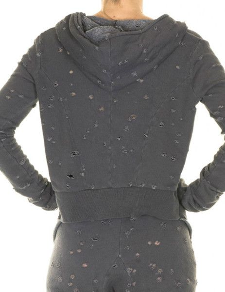 This cool distressed zip track hoodie from Tusnelda Bloch are a stylish choice for everyday wear.     Antracit black tracksuit cardigan with zipper, oversized hoodie - with a small piece of ribbed hem on back and on the sleeves.     The back is tailored/fitted .  80% destroyed cotton  #Futuristic #fashion #minimalistic #danishdesign  Find it in our webshop:  www.butikbutik.dk  (or click on the piture)