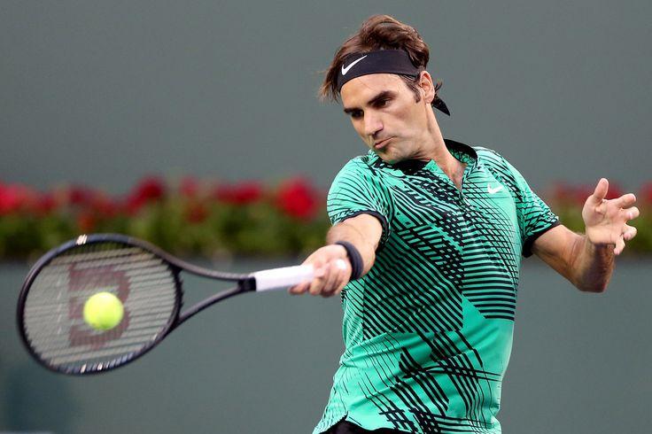 Roger Federer Photos Photos - Roger Federer of Switzerland returns a shot to Steve Johnson during the BNP Paribas Open at the Indian Wells Tennis Garden on March 14, 2017 in Indian Wells, California. - BNP Paribas Open - Day 9
