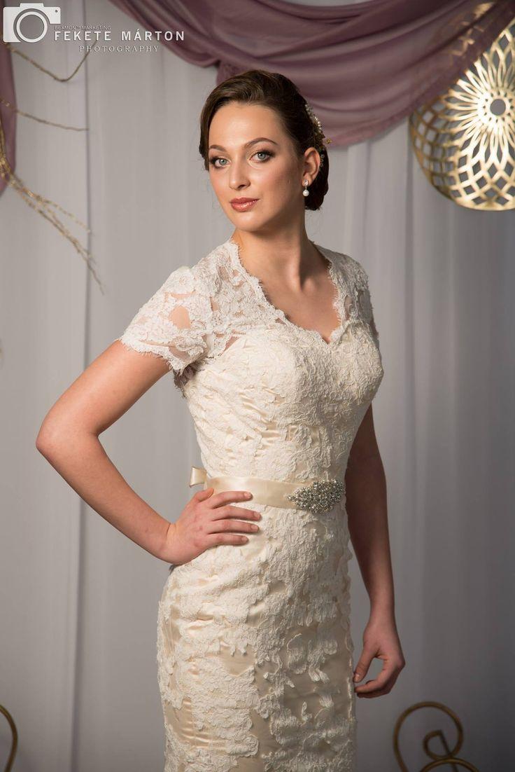 Vintage style, ivory with cream underlay wedding dress.