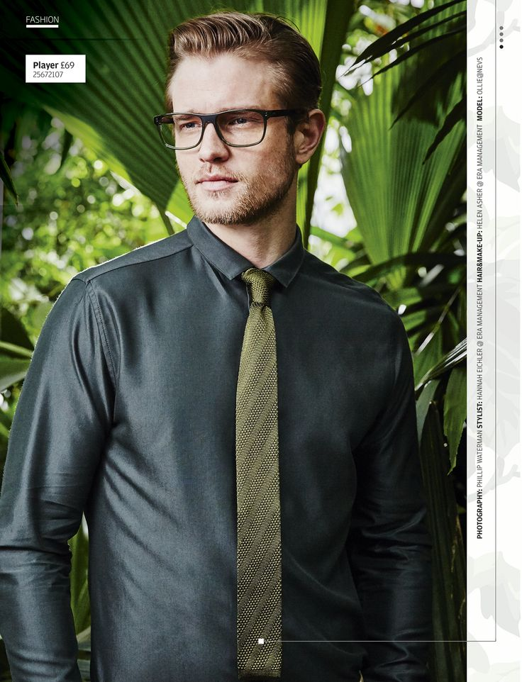 Ooze style in a metallic grey shirt, quirky olive tie, chinos and large specs.