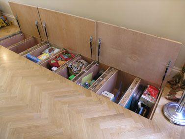Hidden storage in between the floor joists.