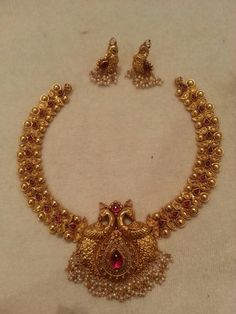 Antique bridal necklace and earrings. Peacock design. Indian jewellery.