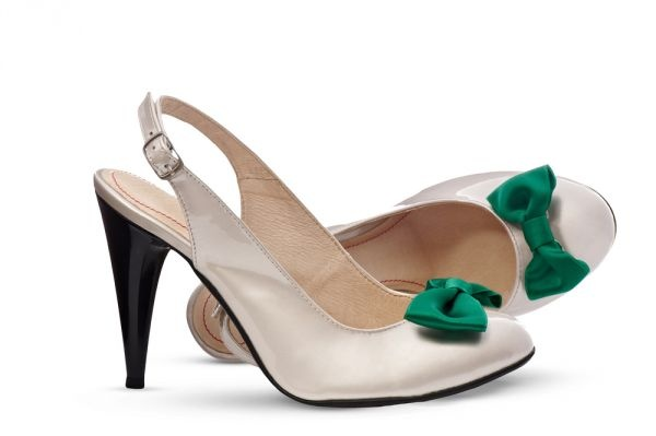 Pumps in pearl lacquered colour brightened up by vivid green bow will set a new trend in summer elegance especially for you. More on: http://mysfashion.com