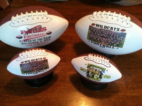 Our personalized footballs are the perfect gift for the seniors, coaches and players! The balls come in two different sizes: mini and full regulation size. The full size is $39.95 and allows printing on two panels. All balls come with a black base for displaying them.