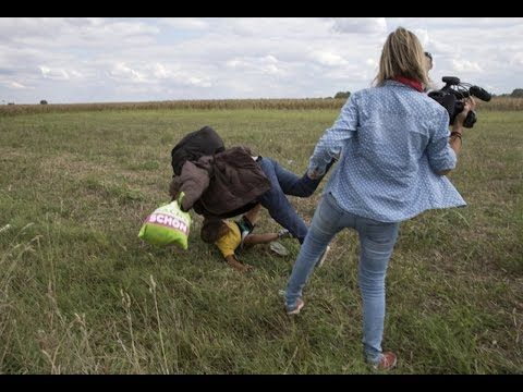 Camerawoman Caught Tripping Syrian Refugee Carrying Child | 8Share Philippines