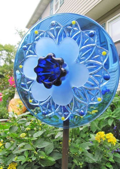 Imagine midcentury dishes transformed into a garden art plate flower! This piece was designed to stand on a stake in your garden or yard and