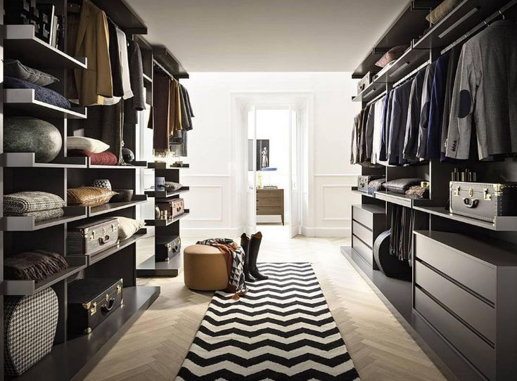 One has to love the pattern in the rug of this modern walk-in closet  www.bocadolobo.com #bocadolobo #luxuryfurniture #exclusivedesign #interiodesign #designideas #walkinclosetideas #bedroomideas #walkinclosets #geometricwalkincloset