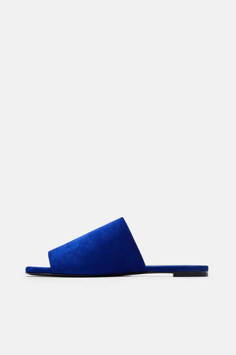 Under the creative direction of Roland Mouret, Robert Clegerie's legacy of pure, architectural shapes continues. This ultramarine slide is the ultimate in ease. Crafted in France, the sleek style pairs a broad band of velvety suede with a low, stacked heel. Ensuring wear-all-day comfort are a smooth leather lining, lightly padded leather insole, and leather outsole. Also available in skin.