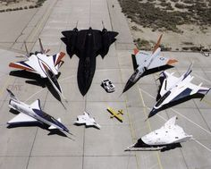A collection of NASA's research aircraft on the ramp at the Dryden Flight Research Center in July 1997: X-31, F-15 ACTIVE, SR-71, F-106, F-16XL Ship #2, X-38, and X-36.