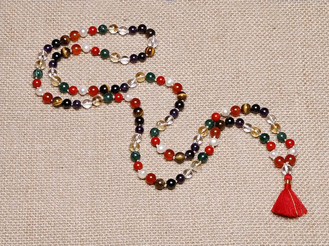 This rare mala consists of 9 semi-precious stones, each one representing a planet of the solar system. Stones include carnelian (Sun), pearl (Moon), coral (Mars), aventurine (Mercury), citrine (Jupiter), quartz (Venus), amethyst (Saturn), garnet (Raku), and tiger's eye (Ketu). Strung together, these stones are thought to restore balance where needed in the wearer's astrological chart.  http://atmasofferings.com/product/planetary-mala/