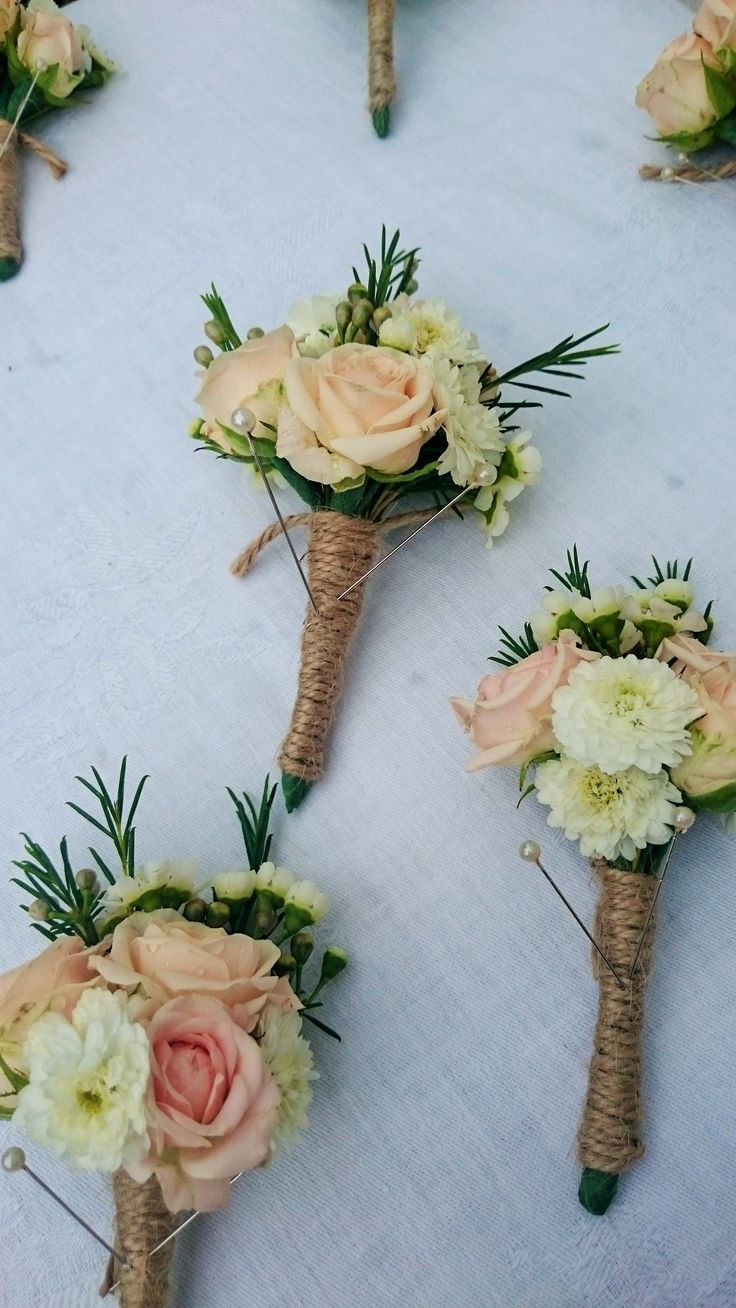 Pretty, rustic buttonholes for a summer wedding