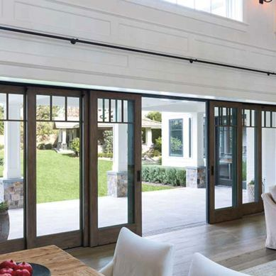 These telescoping sliding doors are beautiful with their craftsman style detailing and when they're open it brings the beauty of the outdoors, in!