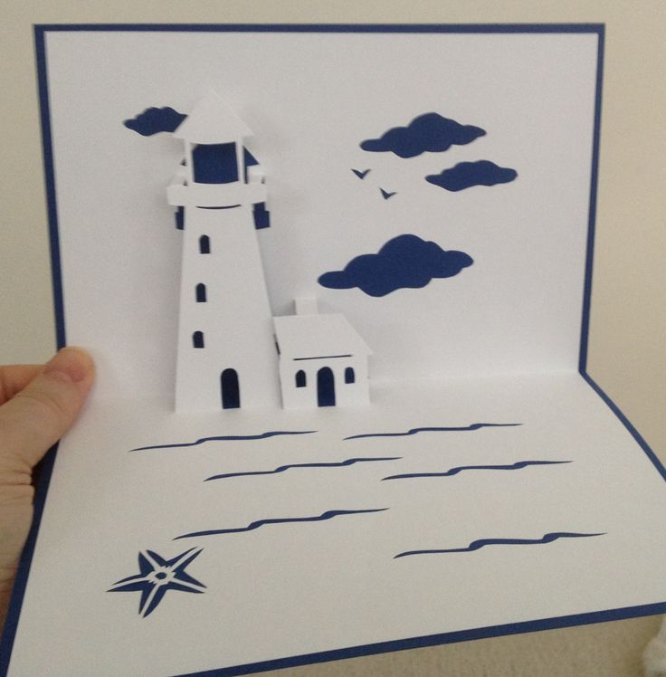 Seaside lighthouse pop-up card (Template at http://www.susanbluerobot.com/2008/06/light-way-pop-up-card-plus-pattern-for.html)