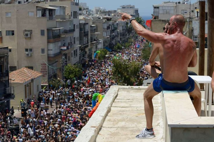 Men are watching from a roof at the annual gay pride parade in Tel Aviv, June 09, 2017. About 200,000 members of the Israeli and international gay community participated the annual gay pride parade in Tel Aviv.   Photo: NurPhoto/NurPhoto Via Getty Images
