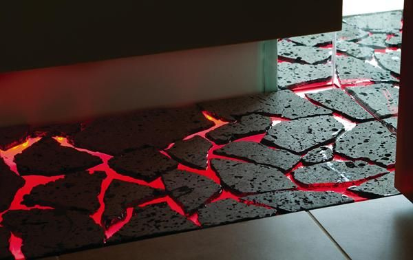 Can you imagine having a walkway of this to a tiki bar patio?? New thing on my need list. Stone set on a glass sheet that is lit red by LED lighting--The floor is lava!