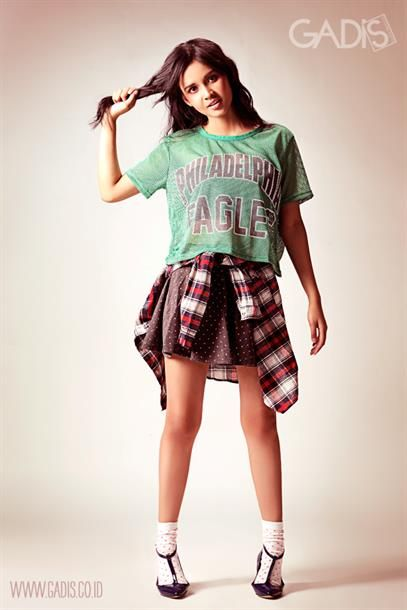 Another way to look grunge: jersey cropped top, mini skirt, and tied check shirt.